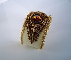 Bead Embroidery Bracelet Cuff Bead embroidery earring Seed bead jewelry Cream Gold Bronze Swarovski. $125.00, via Etsy.