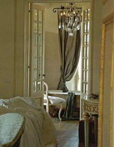 love these drapes...and the chandelier...and the french doors
