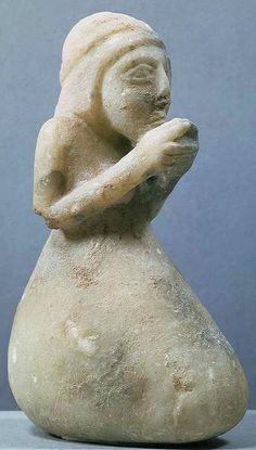 3,300 BCE. Alabaster Seated Sumerian Figure from Uruk (Iraq).