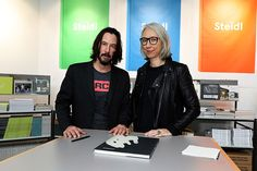 """Actor Keanu Reeves and Artist Alexandra Grant are seen posing by their book """"Ode to happiness"""" during """"Paris Photo"""" at le Grand Palais on November 2017 in Paris, France. Get premium, high resolution news photos at Getty Images Keanu Reeves Alexandra Grant, Keanu Charles Reeves, Keanu Reeves Girlfriend, Ode To Happiness, California College Of Arts, Los Angeles Film Festival, Hollywood, Grand Palais, Paris Photos"""
