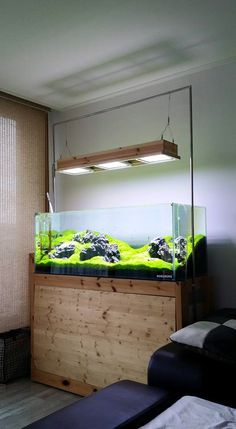 simonsaquascapeblog: Favourites: tank and cabinet by 신승협‎This is one of the coolest cabinets I have never seen. Let me know if you find more information about it or pictures of it.