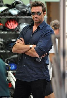 Muscles: Hugh strikes a familiar pose showing off his hunky arms