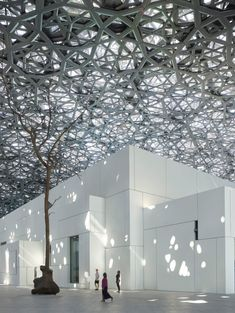 Jean Nouvel's Louvre Abu Dhabi features a huge patterned dome