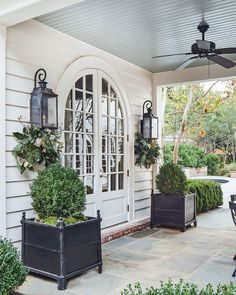 Holiday Decorations in an Elegant Charlotte, North Carolina Home, decorations exterior Holiday Decorations in an Elegant Charlotte, North Carolina Home, Christmas House Lights, North Carolina Homes, South Carolina, House Entrance, Entrance Doors, Outdoor Living, Outdoor Decor, White Houses, Porches