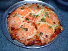 Napolitana:rodajas de tomate fresco ajo y perejil