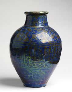 Jar of fritware, painted in yellow lustre over a cobalt blue glaze, Syria, probably Damascus, 1300-1400