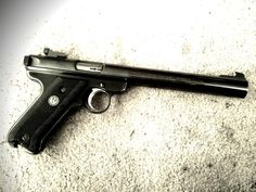 Ruger Mark II w/ bull barrel - My first pistol loved it accurate as hell and never jammed. Till some kid broke in and stole it - I hope you shoot your eye out kid...
