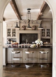 love the stools and the wood beam idea