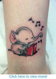 My friend$#39;s gorgeous elephant piano tattoo :)