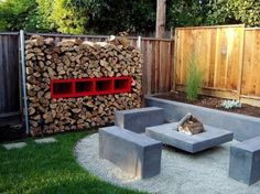 exterior: Awesome Sitting Space Of Cool Backyard Ideas By Applying Concrete Seat And Unique Fireplace Desk Surrounded By Wooden Perimeter Walls - Attractive Cool Backyard Ideas for Better Outdoor Scenery, Luxury Busla: Home Decorating Ideas and Interior Design