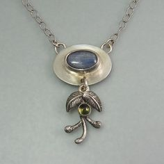 "Woodland necklace with blue kyanite, peridot, vines and leaves in sterling silver.  ""Avalon Necklace"" by Kryzia Kreations    http://www.kryziakreationsstudio.com/products/avalon-necklace  $265.00"