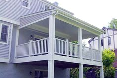 Covered deck designs pictures of decks deck photos for Cheap decking boards uk