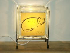 Yellow golden cat eco-friendly glass block night light. Handmade lighting from recycled steel wire and recycled plastic from dustcovers. on Etsy, $46.00