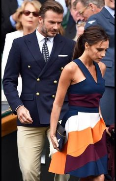 David Beckham wearing White Dress Shirt, Navy Print Tie, White Pocket Square, Navy Double Breasted Blazer, and Beige Dress Pants
