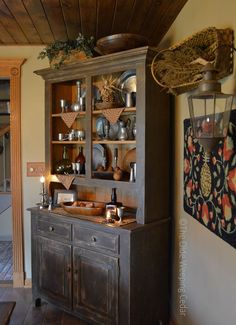 The Olde Weeping Cedar. I like the colorful piece on the wall, the gorgeous cabinet, and the warmth.