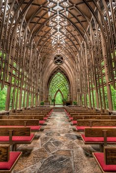 MILDRED B. COOPER MEMORIAL CHAPEL:  designed by Arkansas architects E. Fay Jones & Maurice Jennings in 1988. This steel and glass chapel sits on a wooded hilltop overlooking Lake Norwood in Bella Vista, Arkansas. Jones used steel and glass to create a series of Gothic arches that run the length of the chapel. Jones also designed everything in the chapel, from the light fixtures to the furniture and moldings, to blend with its surroundings.