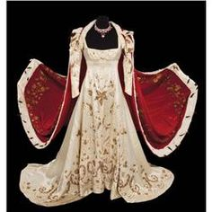 """Merle Oberon """"Empress Josephine"""" Coronation gown with velvet and ermine robe from Desirée. (TCF, 1954) Elaborate coronation ensemble of ivory satin jeweled gown by René Hubert, with gold embroidered leaves and Fleur-de-lis, together with a monumental (92"""" x 102"""") crimson velvet cape trimmed all-around with white fur and ermine tails, worn by Merle Oberon as """"Empress Josephine"""" when Napoleon crowns himself emperor in Desiree."""