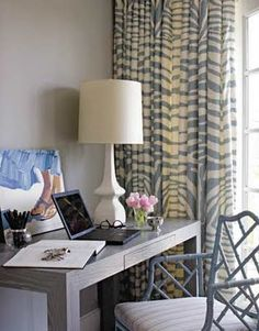 What a great office. Really love the subtle zebra print on curtains.