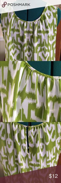 Green and White Sleeveless Blouse XL New without tags flowy green and white sleeveless blouse by Anna. Size XL. Buttons in the back. Anna Tops Blouses
