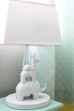 Lamp found on clearance and spray painted white to mimic the look of an out-of-budget lamp! #DIY #nursery #kidsroom