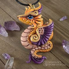 Dragon pendant necklaces now available from Windloft Workshop!   This golden, feathered dragon is one of my favorites of the lot—she'll be difficult to part with!