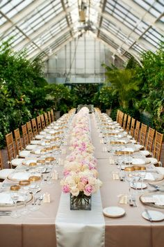 How cool would it be to have a wedding ceremony inside of a greenhouse?