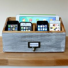 Letter sorter turned into a family charging station! Love this idea especially with the plug that's for four usb's!!!