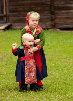 Scandinavian 19th Century Folk costumes from Boda, Dalecarlia. The little boy lost his hat sometime during the photo shoot, he would normally have had his head covered too.