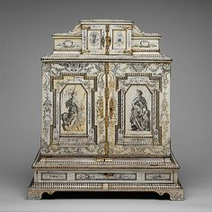 Cabinet made of oak, pine, walnut, cedar, ebony and rosewood with ivory and silver veneer, silver, silver-gilt moldings, gilded yellow-metal mounts and drawers lined with aquamarine-colored silk created by Melchior Baumgartner [Augsburg, Germany], c. 1655–59 (worked on 1825–50). The three central plaques inside the cabinet depict the Roman gods of agriculture (Ceres, at left), wine (Bacchus, at center), and love (Venus with Cupid, at right).