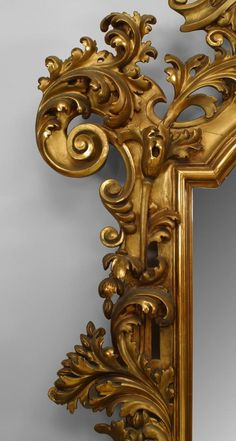 Italian Rococo (Florentine 19th Cent) wall mirror with extensive foliate carved and filigree frame with a shell form pediment top