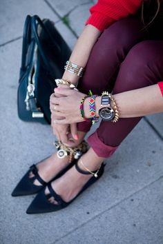 Red sweater and burgundy skinny jeans