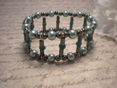 Add some flare and make a statement with this Green Swarovski Pearl and Hematite Cuff Bangle Bracelet. Now 50% Off at www.NiteDreamerDesigns.ArtFire.com