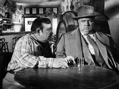 Akim Tamiroff and Orson Welles in TOUCH OF EVIL (1958). Directed by Orson Welles.