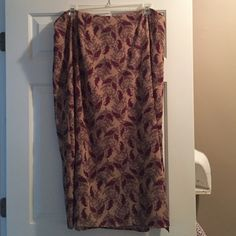 Villager Woman by Liz Claiborne floral skirt Very pretty skirt with side slit. Pretty pattern lined with tan on inside. Wears good and lays very pretty Villager Woman by Liz Claiborne Skirts