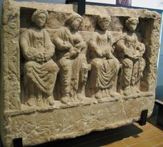 3rd Century AD Roman limestone relief of 4 mother goddesses, found reused as building material in London. These deities may represent a merging of native or local British goddesses with deities from the traditional Roman pantheon.