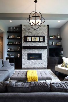 Transitional formal living room with gray walls, dark wood floors, a ribbon fireplace, a stone fireplace surround and a tv stand #modernroomdecorpictures