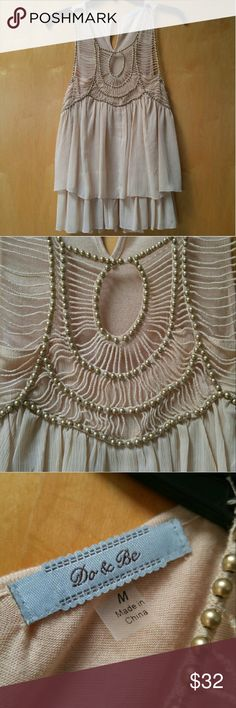 """Do & Be Beige Flowy Gold Beaded Tank Do & Be sleeveless blouse, size medium, in excellent condition! This top is so incredibly adorable! Features gorgeous gold beading on neckline. Keyhole at back of neck. Two layer, flowy body. 17"""" pit to pit and 27"""" length. Please ask any questions. No trades. Make a reasonable offer. Thanks! Do & Be Tops Blouses"""