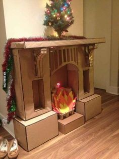 Funny pictures about Epic Cardboard Fireplace. Oh, and cool pics about Epic Cardboard Fireplace. Also, Epic Cardboard Fireplace photos. Christmas Fireplace, Noel Christmas, Christmas Crafts, Christmas Decorations, Fake Fireplace, Christmas Stockings, Christmas Grotto Ideas, Artificial Fireplace, Christmas Program