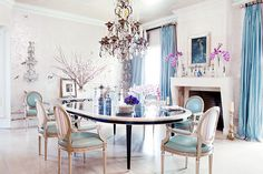Sharon and Ozzy Osborne's Cloud-Like Dining Room // gilded silver wallpaper, French chandelier, blue silk drapes, oval-back dining chairs