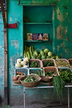 Fresh produce market on the street in asia. Beautiful green fruits and vegetables being sold on the street with some iconic buddah paintings behind the baskets. Oh to travel the world and be buying veggies here! Yoga Studio Design, Shades Of Green, Blue Green, Fruits And Veggies, Vegetables, Farmers Market, Produce Market, My Favorite Color, Color Inspiration