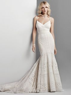 A stunning lace gown with a trumpet flare that makes a statement.