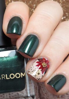 This dark autumnal shade of green is an absolute hit. Everything becomes even more interesting when green color is enriched with diamond brilliance. One nail in gentle beige with a red flower refreshes the whole manicure and makes it a real work of art.