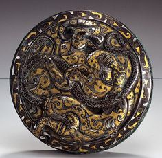Late Eastern Zhou Chinese Bronze Round Lid with Inlay      	Bronze with silver and gold foil  inlay, late 4th-3rd century  B.C.E.