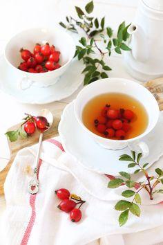 Rosehip tea and berries by photosimysia