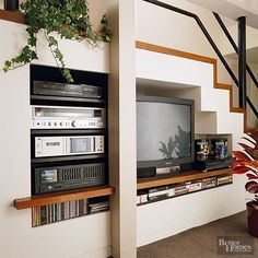 granted the TV is 1990's dated, but the idea of putting the TV in the wall under the stairs is brilliant! What a space saver! If You Grew Up in the 90s, This Will Take You Back to Your Childhood Home