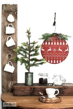 "Love cute AND super easy Christmas projects? You're in for a treat...After rummaging through my junk stash, I came across a broken lazy susan I had collected off the curb.""Hmmm.... that looks like a Christmas ornament..."" I mused.So, I made it happen!And it was super easy. All you need is a wood round of any size, another small chunk of wood, a stencil if desired and BOOM!Wait until you see how cute this turned out!"