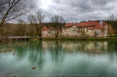 The Otocec castle seen from one shore of the river Krka in Slovenia