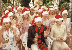 It's Christmas in Stepford: a time to make Santa Clauses out of pinecones. Mind-numbingly boring for most people, thankfully robots don't notice [The Stepford Wives, 2004; actors: Nicole Kidman, Faith Hill, Roger Bart and Eha Urbsalu)