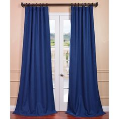 Rich in texture these heavy blue curtains are gracefully crafted. Woven from sturdy polyester for the perfect weave and fall, each panel is finished with our exclusive 3-inch pole pocket with hidden back tab and hook belt header for a modern look.