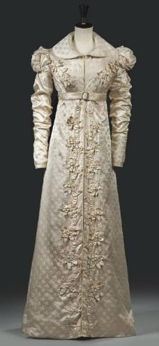 Redingot Walking Dress: ca. 1818-1820, French, sprigged silk, applied with applied with three-dimensional floral frieze, belted, with a shawl collar and with puffed epaulettes.
